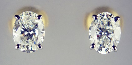 Oval diamond earstuds in 18ct white & yellow gold - Matched pair of 0.97ct and 0.95ct oval white diamonds both G colour VS clarity with GIA diamond reports, mounted in 18ct white and yellow gold with loss-proof (alpha) fittings