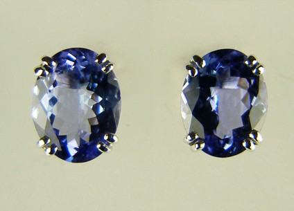 Tanzanite earstuds - 3.5ct pair of oval faceted tanzanites 9 x 7mm, mounted as earstuds in 18ct white gold
