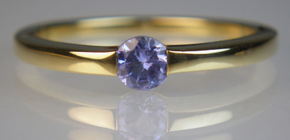 Tanzanite ring in 9ct yellow gold - Simple ring in 9ct yellow gold set with a single round cut tanzanite. Tanzanite is a soft gemstone and should be worn with care.
