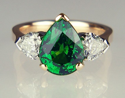 Tsavorite garnet & heart shaped diamond ring in rose gold - 3.39ct pear cut tsavorite garnet flanked by a 0.81ct matched pair of G colour VS clarity heart shaped diamonds mounted in platinum and 18ct rose gold