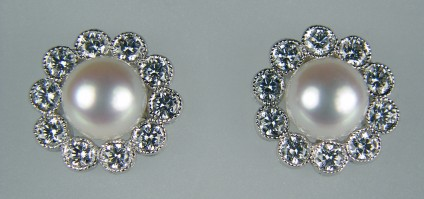 Pearl and Diamond Earrings - Pearl and 0.46ct diamond cluster earrings in 18ct white gold