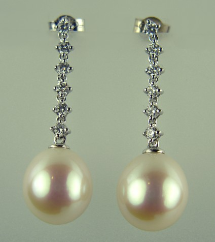 Pearl and Diamond Earrings - Pearl and 0.37ct diamond earrings in 18ct white gold. Pearls approximated 10mm in length.  Total earring drop 30mm.