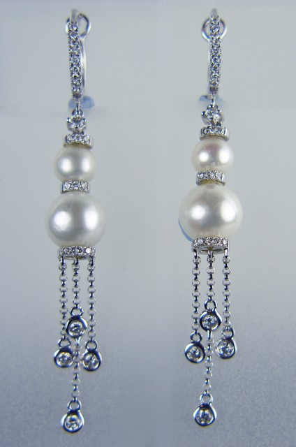 Pearl and Diamond Earrings - Pearl and 0.55ct diamond earrings in 18ct white gold. Largest pearl is 8mm, total earring length 58mm.