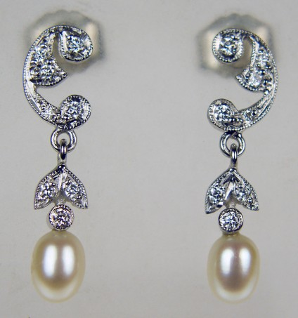 Dainty pearl & diamond earrings in 18ct white gold - 0.15ct diamonds of G colour VS clarity set with dainty pearl drops in 18ct white gold. Earrings 22mm long.
