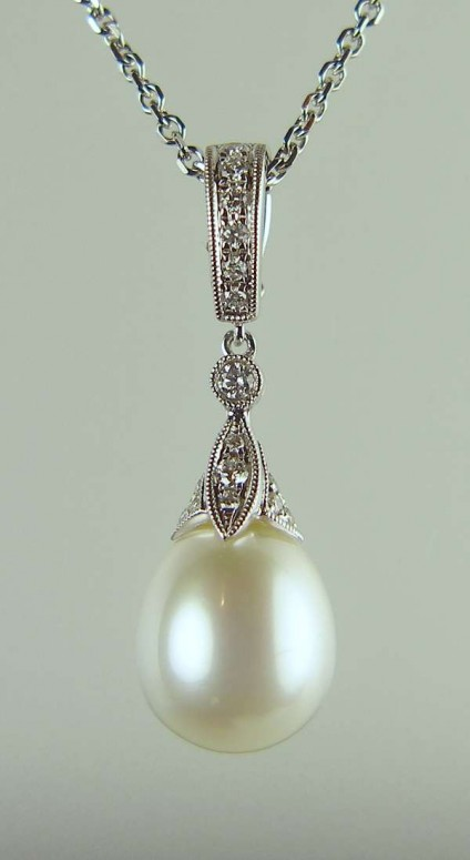 "Pearl & diamond pendant - 0.25ct diamond and south sea pearl pendant with delicate millegrain edging in 18ct white gold and suspended from  20"" 18ct white gold chain"