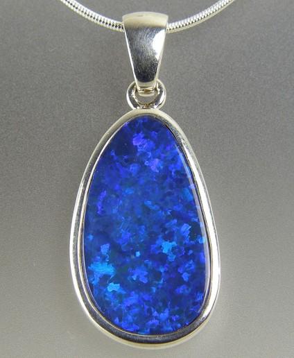 Boulder opal pendant in silver - Boulder opal pendant in silver on silver chain. Pendant 12x29mm.