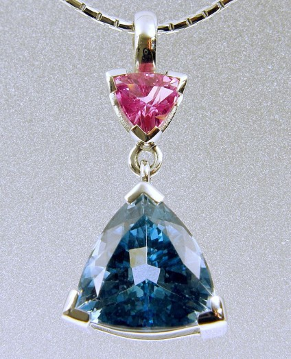 Aquamarine & pink sapphire pendant - Brazilian aquamarine and pink sapphire trillion pendant in 18ct white gold. 2.3cm long set with 2.46ct aquamarine and 0.44ct pink sapphire.