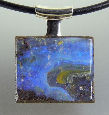 Boulder opal pendant in silver - Boulder opal pendant in silver on leather thong. Pendant 22x28mm.