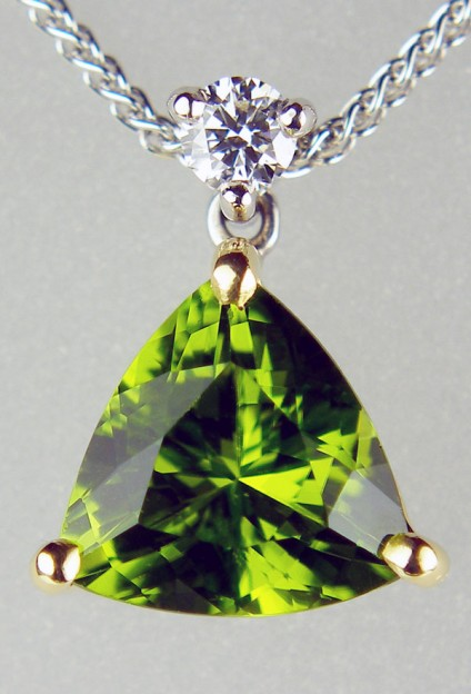 Peridot & diamond pendant in 18ct white & yellow gold -