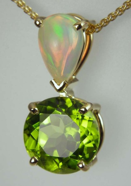 Peridot & opal pendant - 10mm round, 4.19ct round brilliant cut peridot set with 0.86ct Ethiopian opal pear shaped cabochon in 18ct yellow gold.