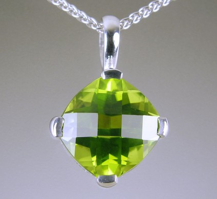 Peridot pendant in gold - Peridot pendant in 9ct white gold set 3.42ct antique cut Burmese peridot. Pendant 17 x 11mm.