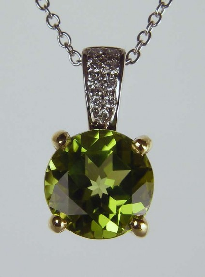"""Peridot & diamond pendant - 2.03ct round peridot set with 0.06ct H/VS diamonds in 18ct yellow and white gold suspended from a 16-18"""" adjustable 18ct white gold chain"""