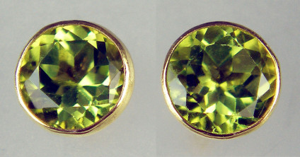 5.5mm round peridot earstuds rubover set in 9ct yellow gold - 1.15ct pair of round cut peridots rubover set in 9ct yellow gold earstuds. Earstuds are 5.5mm in diameter