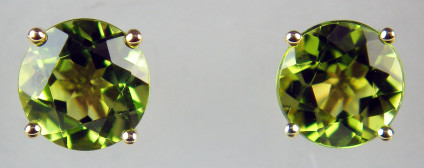7mm peridot round earstuds in 9ct yellow gold - 7mm round pair of peridots weighing 2.85ct and claw set in 9ct yellow gold earstuds