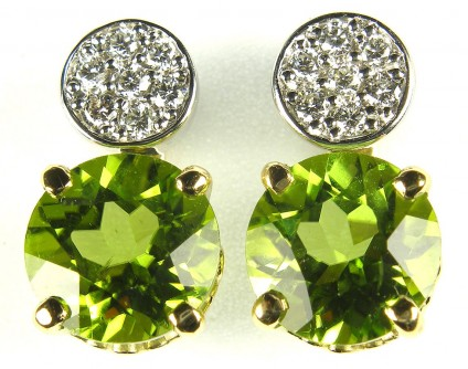 Peridot & diamond earrings in 18ct gold - 4.48ct peridot round pair set as detachable drops from 0.21ct total diamond weight cluster stud earrings.
