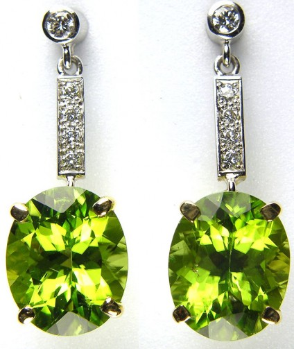Peridot & diamond earrings in 18ct gold - Peridot & diamond earrings in 18 ct yellow & white gold set with 7.86ct pair of peridot ovals and 0.22ct diamond round brilliant cuts.