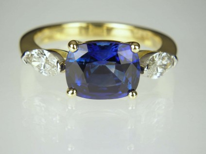 Sapphire & Diamond Ring - 2.78ct Madagascan rectangular cushion cut sapphire set with 0.48ct F colour VS clarity marquise cut diamonds.  Diamonds mounted in platinum, sapphire and ring shank in 18ct yellow gold.