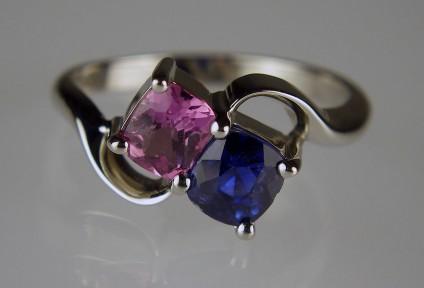 Pink & Blue Sapphire Ring - 0.60ct pink sapphire and 0.97ct blue sapphire cushion cut set in palladium