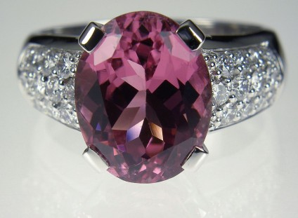 Pink tourmaline & diamond ring - Pink Tourmaline & Diamond Ring. Ring of 5.27ct oval pink tourmaline set with 0.66ct diamonds in 18 carat white gold Central stone 10 x 12mm.