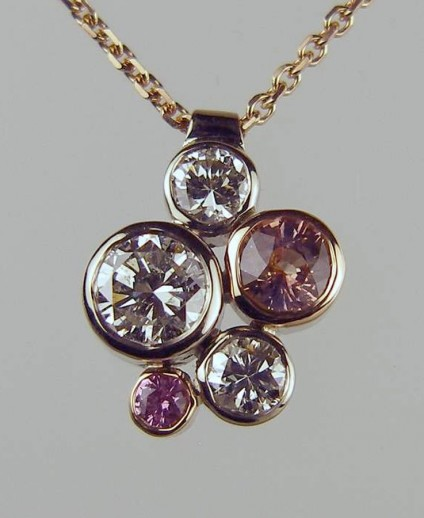 5 Stone Pink Sapphire & Diamond Pendant - 5.3ct and 0.11ct pink sapphires with a pair of 0.27ct diamonds and a 0.87ct diamond set in 18ct white and rose gold and suspendedn from a rose gold chain