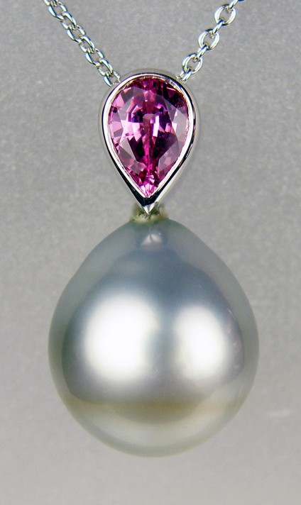 Pink sapphire & Tahitian pearl pendant in 18ct white gold - 0.84ct pink sapphire set with silvery coloured drop shaped Tahitian pearl mounted in 18ct white gold and suspended from an 18ct white gold chain. Pendant measures 22mm long