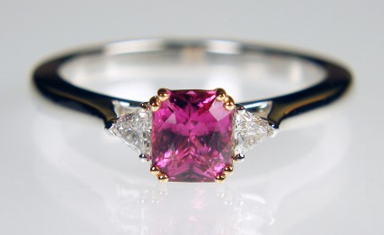Pink sapphire & trillion cut diamond ring in rose & white gold - 0.95ct radiant cut pink sapphire set in 18ct rose gold and flanked by 0.12ct G/VS quality, trillion cut diamond pair mounted in 18ct white gold