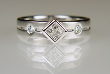 Princess cut diamond ring in frosted white gold - 0.24ct of princess cut and round brilliant cut diamonds in H colour VS clarity and set in a satin and polished 18ct white gold ring