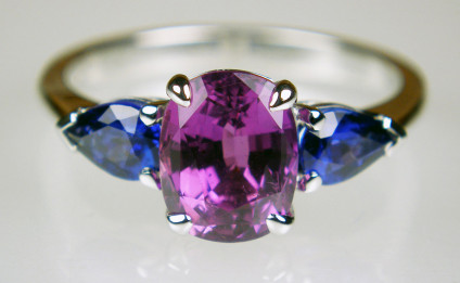 Purple & blue sapphire ring in 18ct white gold - 2.62ct cushion cut magenta sapphire , set with a 0.85ct matched pair of pear cut blue sapphires in 18ct white gold