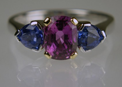 Purple & Blue Sapphire Ring - 2.08ct cushion cut rectangular purple sapphire set with a pair of 1.23ct trillion cut blue sapphires set in 18ct white and yellow gold