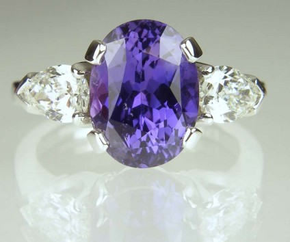 Purple sapphire & diamond ring - 4.27ct oval purple colour change natural certified unheated sapphire, set with 0.80ct pair of pear cut diamonds G colour VS clarity, in platinum.