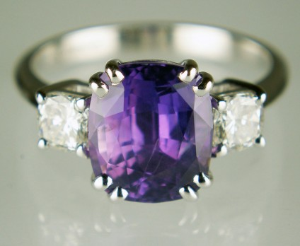 Purple sapphire & diamond cushion cut ring - superb quality 4 carat cushion cut purple sapphire set with a 0.62ct matched pair of F colour VVS clarity cushion cut diamonds in 18ct white gold.  The sapphire is unheated.
