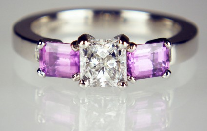 Purple sapphire & diamond ring - 0.50ct square radiant cut diamond D colour VS2 clarity with GIA report, flanked by a matched pair of 0.95ct emerald cut natural purple sapphires and a 0.035ct pair of princess cut diamonds, mounted in platinum.