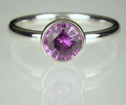 Purple Sapphire Ring - 1.11ct round brilliant cut purple sapphire (certified unheated) in 18ct white gold rubover set ring