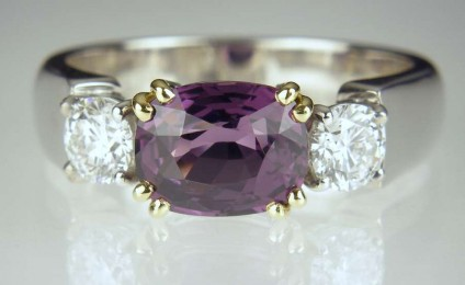 Purple Spinel & Diamond Ring - 2.73ct cushion cut deep magenta purple spinel set with a matched pair of 42pt round brilliant cut diamonds in E colour SI clarity with GIA certificates, mounted as a ring in 18ct white & yellow gold
