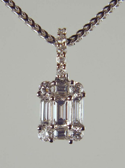 """Diamond Pendant - 0.52ct emerald, baguette and round brilliant cut diamonds set as a pendant in 18ct white gold, suspended from a franco style 20"""" 18ct white gold chain. Matching earrings are available."""