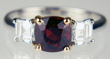 Red spinel & Asscher cut diamond ring in platinum & yellow golf - Lady's dress ring in platinum set with a 1.15ct central cushion cut natural red spinel from Myanmar, claw mounted in 18ct yellow gold, and flanked by a 0.59ct matched pair of Asscher cut diamonds of G-H colour & VVS clarity, claw mounted in platinum.