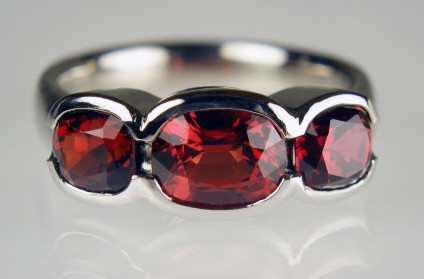 Red spinel & palladium ring - 3 stone cushion cut red spinels from Myanmar set in palladium.  Central stone is 1.74ct and the flanking pair of cushion cuts are 2.20ct in weight.