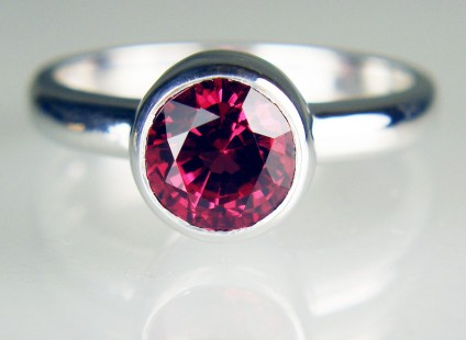 Red spinel ring in 18ct white gold - 7mm round 1.79ct red spinel set in 18ct white gold ring with rubover setting