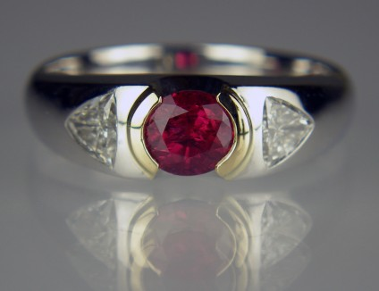 Ruby & diamond ring in platinum - 0.82ct oval cut natural ruby set with a 0.52ct pair of trillion cut diamonds in 18ct yellow gold and platinum
