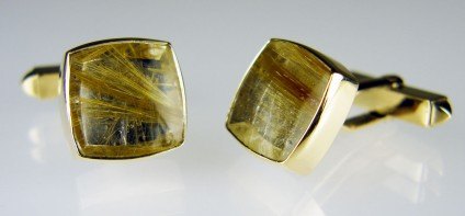 Rutilated quartz cufflinks in 9ct yellow gold - Pair of square cushion cut cabochon rutilated quartz rubover set in 9ct yellow gold cufflinks. Cabochon pair weigh 14.9ct.