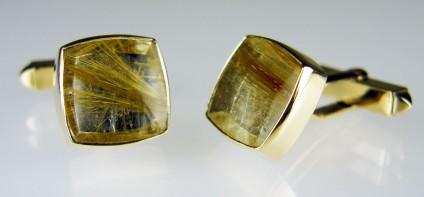 Rutilated quartz cufflinks in 9ct yellow gold - Pair of square cushion cut cabochon rutilated quartz rubover set in 9ct yellow gold cufflinks. Cabochon pair weigh 14.9ct.