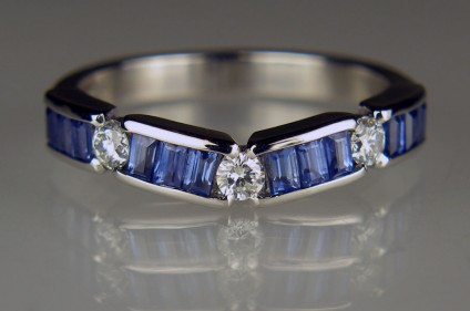 Sapphire & diamond ring in platinum - Round brilliant cut diamonds totalling 0.2ct in F colour VS clarity set off the brilliant blue of 0.98ct baguette cut sapphires in this gently curving handmade ring in platinum, designed to fit around the customer's platinum and diamond 3 stone engagement ring.