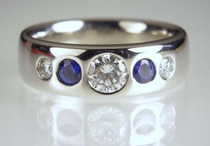 Sapphire & diamond ring in palladium - 0.32ct diamond F/SI1 set with 0.27ct pair of round cut blue sapphires and a 0.12ct pair of F/VS diamonds in palladium