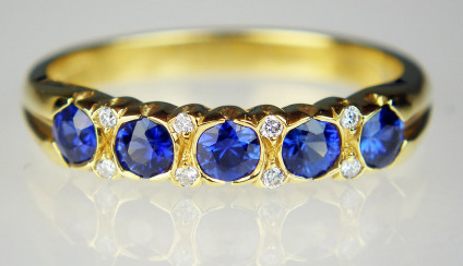 Sapphire & diamond ring in 18ct yellow gold - 0.55ct sparkling royal blue sapphires set with 0.04ct diamonds in 18ct yellow gold ring. Ring size M. Can be sized up, but now down!