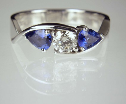 Sapphire & Diamond Twist Ring - Round brilliant cut diamond 0.42ct set with a matched pair of pear cut sapphires totalling 0.8ct mounted in platinum