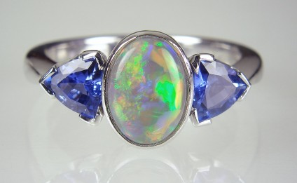 Black opal & sapphire ring - Sapphire & opal ring - Ring set with 1.15ct black opal and 0.91ct pair of trillion cut sapphires.