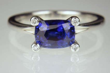 Sapphire & diamond ring in platinum - 2.13ct finest colour blue, cushion cut sapphire set with tiny diamond set claws in platinum ring