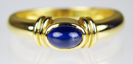 Sapphire cabochon ring in 18ct yellow gold - 0.5ct oval cabochon sapphire mounted in simple 18ct yellow gold ring