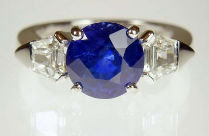 Sapphire & diamond ring in platinum - 4.1ct round sapphire of exceptionally fine colour, set with a 0.63ct matched pair of G colour VS1 clarity taper cut diamonds in platinum