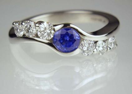 Sapphire & Diamond Ring - Sapphire & diamond ring with 0.58ct round sapphire and 0.58ct round brilliant cut diamonds in F colour VS clarity, mounted in platinum